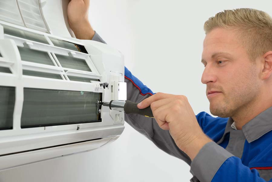 Technician Repairing Air Conditioner, Technician Repairing Air Conditioner, Do I Really Need an Air Conditioner Tune-Up? | HVAC Service, AC